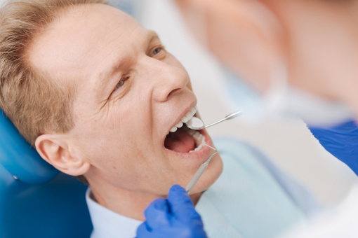 Middle aged man having his teeth checked, prevatative dentistry